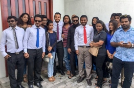 Raajje TV staff pictured outside the Criminal Court. FILE PHOTO/MIHAARU