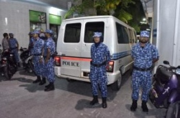 Police officers keeping peace by Qasim Ibrahim's house at the time of his arrest on April 6, 2017. PHOTO: NISHAN ALI/MIHAARU