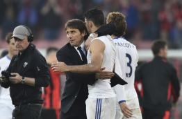 Chelsea's Italian head coach Antonio Conte (L) embraces Chelsea's Brazilian-born Spanish striker Diego Costa (R) at the end of the English Premier League football match between Bournemouth and Chelsea at the Vitality Stadium in Bournemouth, southern England on April 8, 2017. / AFP PHOTO / Glyn KIRK / RESTRICTED TO EDITORIAL USE. No use with unauthorized audio, video, data, fixture lists, club/league logos or 'live' services. Online in-match use limited to 75 images, no video emulation. No use in betting, games or single club/league/player publications. /