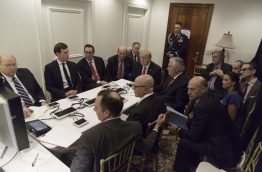 "President Trump, staring directly ahead, is surrounded at the table by (clockwise from left) Deputy Chief of Staff Joe Hagin, son-in-law Jared Kushner, Treasury Secretary Steven Mnuchin, Commerce Secretary Wilbur Ross, Secretary of State Rex Tillerson, National Security Adviser H.R. McMaster and Chief of Staff Reince Priebus. Sitting a row back from the table are Sean Spicer, chief strategist Stephen Bannon, senior adviser Stephen Miller, national security aide Michael Anton, Deputy National Security Adviser Dina Powell, and National Economic Council Director Gary Cohn. A military aide guards the door. / AFP PHOTO / WHITE HOUSE / - / RESTRICTED TO EDITORIAL USE - MANDATORY CREDIT ""AFP PHOTO / WHITE HOUSE "" - NO MARKETING - NO ADVERTISING CAMPAIGNS - DISTRIBUTED AS A SERVICE TO CLIENTS"