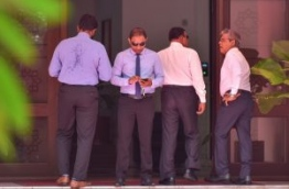 Lawmakers pictured outside the parliament. PHOTO: HUSSAIN WAHEED/MIHAARU
