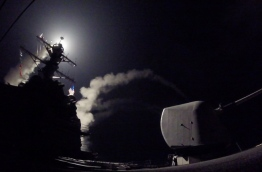 "US President Donald Trump ordered a massive military strike on a Syrian air base on Thursday in retaliation for a ""barbaric"" chemical attack he blamed on President Bashar al-Assad. The missiles were fired from the USS Porter and the USS Ross, which belong to the US Navy's Sixth Fleet and are located in the eastern Mediterranean. / AFP PHOTO / US NAVY / Ford WILLIAMS / RESTRICTED TO EDITORIAL USE - MANDATORY CREDIT ""AFP PHOTO / US NAVY / Mass Communication Specialist 3rd Class Ford Williams"" - NO MARKETING NO ADVERTISING CAMPAIGNS - DISTRIBUTED AS A SERVICE TO CLIENTS"