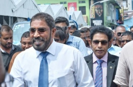 Jumhoory Party leader Qasim Ibrahim greets supporters after finishing his hearing at the Criminal Court. PHOTO: HUSSAIN WAHEED/MIHAARU