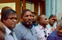 Jumhoory Party leader Qasim Ibrahim outside Villa Shipping and Trading Company office building after a police raid. PHOTO: NISHAN ALI/MIHAARU