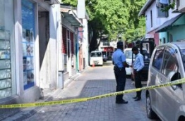 Police officers closed off the area around social media activist Yameen Rasheed's house after he was found murdered with multiple stab wounds. PHOTO: HUSSAIN WAHEED/MIHAARU