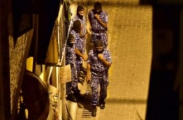 Police SO officers during raids on three places in Machangolhi ward in Male. PHOTO/MIHAARU