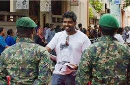 Yameen Rasheed at a march he organised to demand justice for Ahmed Rilwan, a journalist that was allegedly abducted and has been missing for over two years. PHOTO/DANIEL BOSLEY