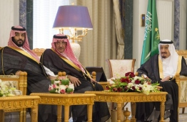 """A handout picture provided by the Saudi Royal Palace on April 24, 2017 shows Saudi Arabia's King Salman bin Abdulaziz al-Saud (R), Crown Prince Mohammed bin Nayef (C), and Deputy Crown Prince Mohammed bin Salman (L) attending a swearing in ceremony for new cabinet ministers and ambassadors in the capital Riyadh. / AFP PHOTO / Saudi Royal Palace / BANDAR AL-JALOUD / RESTRICTED TO EDITORIAL USE - MANDATORY CREDIT """"AFP PHOTO / SAUDI ROYAL PALACE / BANDAR AL-JALOUD"""" - NO MARKETING - NO ADVERTISING CAMPAIGNS - DISTRIBUTED AS A SERVICE TO CLIENTS"""