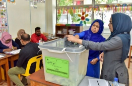A woman casts her vote in a voting centre in Male during the Local Council Elections 2017. PHOTO: NISHAN ALI/MIHAARU