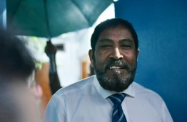 Jumhoory Party leader Qasim Ibrahim pictured in front of his residence after the Criminal Court released him under strict conditions. PHOTO: HUSSAIN WAHEED/MIHAARU