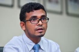 Finance MInister Ahmed Munawar speaks at press conference regarding the Maldives' first credit rating assigned by Fitch Ratings. PHOTO: HUSSAIN WAHEED/MIHAARU