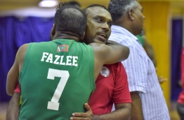 Ali Fazlee (L) embraces Supun Wimal, coach of the Maldives National Basketball Team after winning the SABA Championship match against Sri Lanka on May 23, 2017. PHOTO: NISHAN ALI/MIHAARU