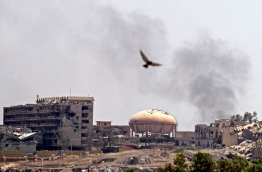 Iraqi forces pressed forward with a broad offensive targeting Islamic State group-held areas in west Mosul and called for civilians to leave areas where fighting is taking place. / AFP PHOTO / KARIM SAHIB