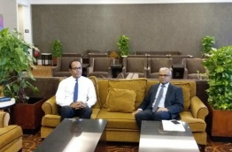 Foreign Minister Mohamed Asim (R) in a lounge at Velana International Airport prior to his departure to Sri Lanka. PHOTO/PRESIDENT'S OFFICE