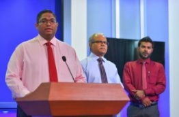 AG Mohamed Anil (L) and Foreign Minister Mohamed Asim (C) speak at press conference regarding the Maldives' decision to severe diplomatic ties with Qatar. PHOTO: HUSSAIN WAHEED/MIHAARU
