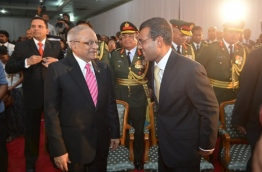 Former presidents Maumoon Abdul Gayoom (L) and Mohamed Nasheed at a function.