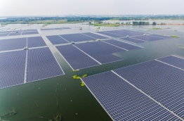 As the United States was withdrawing from the Paris climate pact, China's clean energy ambitions were being reflected in the launch of the world's largest floating solar farm. The 40-megawatt power plant has 160,000 panels resting on a lake that emerged after the collapse of a coal mine in central Anhui province. It is part of Beijing's effort to wean itself off a fossil fuel dependency that has made it the world's top carbon emitter, with two-thirds of its electricity still fuelled by coal. / AFP PHOTO / STR / China OUT / TO GO WITH AFP STORY CHINA-DIPLOMACY-ENERGY-CLIMATE-US,FOCUS BY JULIEN GIRAULT