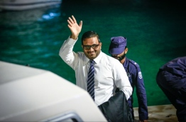 Former VP Ahmed Adheeb escorted to a speedboat on his return to Maafushi Prison after a hearing at the Criminal Court. FILE PHOTO/MIHAARU