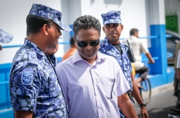 Adam Azim escorted by Police. PHOTO/MIHAARU