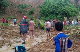 Heavy monsoon rains and landslides have killed at least 134 people in southeast Bangladesh, burying many in their homes as they slept, authorities said. / AFP PHOTO / STR