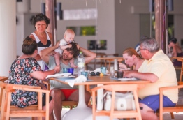 Tourists enjoy lunch in a restaurant at Cocoon Maldives resort. PHOTO: HUSSAIN WAHEED/MIHAARU