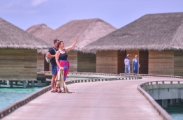 Tourists on the walkway leading to the water villas in Cocoon Maldives resort. PHOTO: HUSSAIN WAHEED/MIHAARU