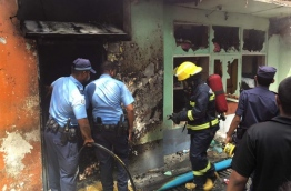 Police and MNDF officers at a scene of a fire after a gas explosion. PHOTO: NISHAN ALI/MIHAARU