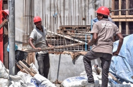 Expatriate workers at work in a construction site. PHOTO: NISHAN ALI/MIHAARU