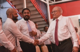 Former President Maumoon Abdul Gayoom (R) shakes hands with his lawmaker son Faris Maumoon PHOTO:Hussain Waheed/Mihaaru