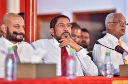 Jumhoory Party leader Qasim Ibrahim (C) and Dhiggaru MP Faris Maumoon (L) at a joint opposition parliamentary group meeting. PHOTO: NISHAN ALI/MIHAARU