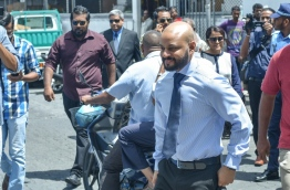 Dhiggaru MP Faris Maumoon arrives at the Criminal Court for his preliminary hearing. PHOTO: HUSSAIN WAHEED/MIHAARU