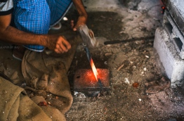 Blacksmith Solih Hussein in GDh Nadellaa. PHOTO/AISHATH NAJ