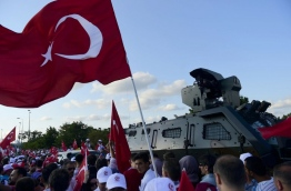 """Turkey is marking one year since the defeat of the coup aimed at ousting President Recep Tayyip Erdogan, seeking to showcase national unity and his grip on power in an increasingly polarised society. The authorities have declared July 15, an annual national holiday of """"democracy and unity"""", billing the foiling of the putsch as a historic victory of Turkish democracy. / AFP PHOTO / YASIN AKGUL"""
