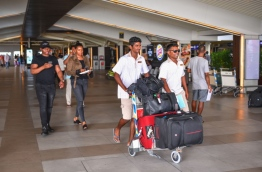Tourists (L) pictured at Velana International Airport.