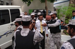 Former President Nasheed escorted to back to prison after being treated at ADK Hospital.