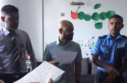 MP Faris Maumoon (C) with police officers