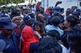 Police break up opposition rally in front of MDP main hub. PHOTO: HUSSAIN WAHEED/MIHAARU