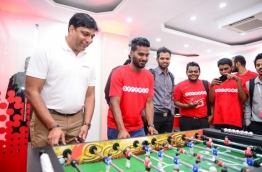 "Vikram Sinha (L) plays a garlando game against famous local footballer Ali ""Dhagandey"" Ashfaq (L-2). PHOTO/OOREDOO"