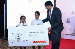 Vikram Sinha (R) pictured at the launching of Ooredoo Smart School project