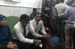 Thulusdhoo MP Mohamed Waheed Ibrahim (C) pictured inside the parliament administration with two other lawmakers after forcefully entering the building.