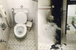 Blackened areas of the toilet cubicle where the fire broke out inside the parliament building