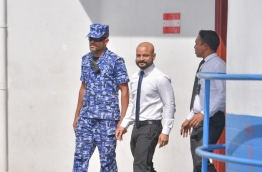 Dhiggaru MP Faris Maumoon on way to Dhoonidhoo Detention Centre after a hearing at the Criminal Court. PHOTO: HUSSAIN WAHEED/MIHAARU