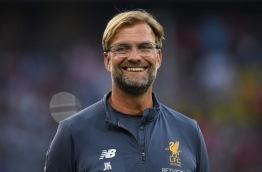 Liverpool's German headcoach Juergen Klopp laughs prior the final Audi Cup football match between Atletico Madrid and FC Liverpool in the stadium in Munich, southern Germany, on August 2, 2017. / AFP PHOTO / Christof STACHE