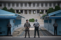 """China urged North Korea August 6 to make a """"smart decision"""", after the United Nations imposed tough new sanctions on the isolated regime over its missile and nuclear programmes. / AFP PHOTO / Ed JONES"""