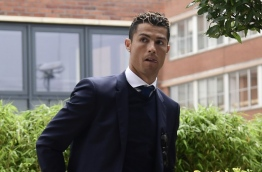 Real Madrid star Cristiano Ronaldo heads to court on July 30, 2017, accused of evading 14.7 million euros in tax through offshore companies in a country only just emerging from a damaging economic crisis. / AFP PHOTO / JAVIER SORIANO
