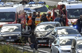 The servicemen were hit by a BMW which drove down a quiet street in the upmarket western Paris suburb of Levallois-Perret. Police later gave chase to the vehicle on a motorway north of Paris, and shot and wounded the suspect, a man aged in his late 30s who was also arrested, sources involved in the manhunt said, speaking on condition of anonymity. French security forces launched a manhunt after a car rammed into anti-terrorism soldiers outside their barracks in a Paris suburb, injuring six. / AFP PHOTO / PHILIPPE HUGUEN