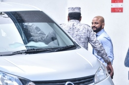 Dhiggaru MP Faris Maumoon escorted back to jail after a hearing at the Criminal Court. PHOTO: HUSSAIN WAHEED/MIHAARU