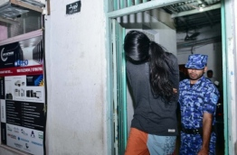 The suspect arrested over Nadeem Abdul Raheem's murder escorted out of a house. PHOTO:/MIHAARU