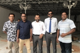 Senior officials of PPM pictured in front of the ruling party's new activity hub which is in development. PHOTO/TWITTER