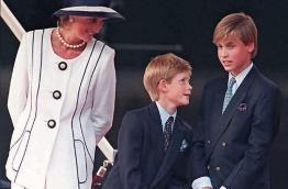 Two decades on from the death of princess Diana, her sons Princes William and Harry are working to keep her legacy alive with unusually emotional tributes after years of official silence. William was 15 and Harry 12 when Diana died in a car crash in Paris on August 31, 1997. / AFP PHOTO / JOHNNY EGGITT
